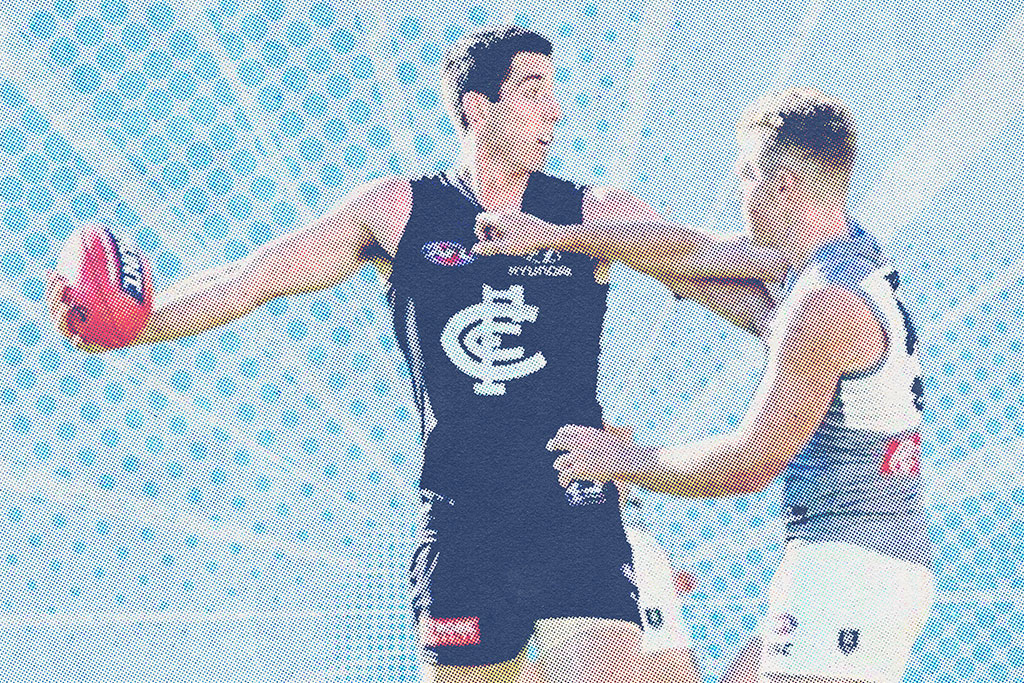 Carlton Blues Player Fending Off and Opponent